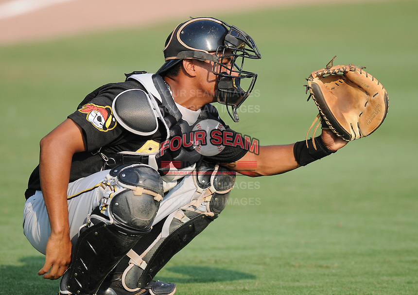 Catcher Elias Diaz (30) of the West Virginia Power, Class A affiliate of the Pittsburgh Pirates, prior to a game against the Savannah Sand Gnats on July 21, 2011, at Grayson Stadium in Savannah, Georgia. (Tom Priddy/Four Seam Images)