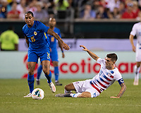 PHILADELPHIA, PA - JUNE 30: Shermaine Martina #15 fouls Christian Pulisic #10 during a game between Curaçao and USMNT at Lincoln Financial Field on June 30, 2019 in Philadelphia, Pennsylvania.