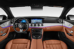 Stock photo of straight dashboard view of 2021 Mercedes Benz E-Class AMG-Line 2 Door Coupe Dashboard