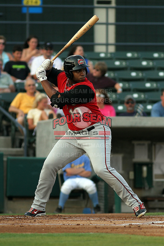 Carolina Mudcats first baseman Jesus Aguilar #10 at bat during a game against the Myrtle Beach Pelicans at Ticketreturn.com Field at Pelicans Park on June 30, 2012 in Myrtle Beach, South Carolina. Myrtle Beach defeated Carolina by the score of 5-4 in 11 innings. (Robert Gurganus/Four Seam Images)