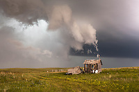 Stormy sky behind an abandoned cabin in Montana