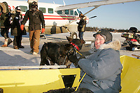 Wednesday March 7, 2007   ---Volunteer Jennifer Ambrose rides in a sled taking dropped dogs to the airstrip at the Nikolai checkpoint on Wednesday in 35 below temperatures