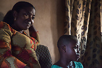 Nigeria. Enugu State. Enugu. Town center. Portrait of a  smiling Igbo woman and a young girl at home. Enugu is the capital of Enugu State, located in southeastern Nigeria. 5.07.19 © 2019 Didier Ruef