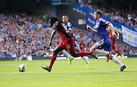 Pictured L-R: Bafetimbi Gomis of Swansea chased by Gary Cahill of Chelsea. Saturday 13 September 2014<br /> Re: Premier League Chelsea FC v Swansea City FC at Stamford Bridge, London, UK.