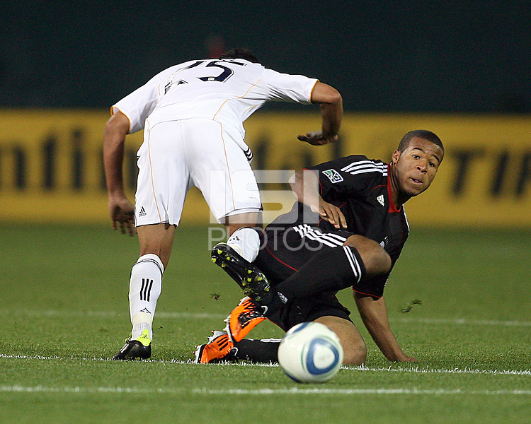 Ethan White (15) of D.C. United  knoocks the ball away from Miguel Lopez (25)of the Los Angeles Galaxy during an MLS match at RFK Stadium, on April 9 2011, in Washington D.C.The game ended in a 1-1 tie.