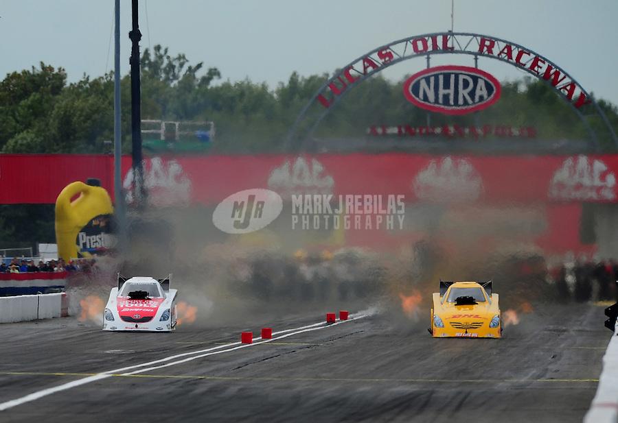 Sept. 5, 2011; Claremont, IN, USA: NHRA funny car driver Cruz Pedregon (left) races alongside Jeff Arend during the US Nationals at Lucas Oil Raceway. Mandatory Credit: Mark J. Rebilas-