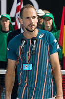 January 31, 2016: Bruno Soares of Brazil in makes a speech after winning the Mixed Doubles Final against Coco Vandeweghe of United States of America and Horia Tecau of Romania on day fourteen of the 2016 Australian Open Grand Slam tennis tournament at Melbourne Park in Melbourne, Australia. Vesnina and Soares won 64 46 105. Photo Sydney Low