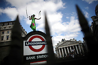 A demonstrator dances outside the Bank of England as thousands of protestors descended on the City of London ahead of the G20 summit of world leaders to express anger at the economic crisis, which many blame on the excesses of capitalism.