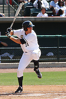 Luke Murton #34 of the Charleston RiverDogs hitting in a game against the West Virginia Power on April 14, 2010  in Charleston, SC.
