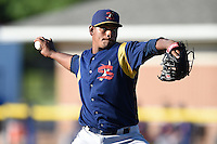 State College Spikes pitcher Fernando Baez (53) delivers a pitch during a game against the Batavia Muckdogs on June 22, 2014 at Dwyer Stadium in Batavia, New York.  State College defeated Batavia 10-3.  (Mike Janes/Four Seam Images)