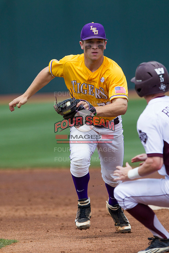 LSU Tigers shortstop Alex Bregman (30) runs down Texas A&M Aggies base runner Brandon Wood (8) during the NCAA Southeastern Conference baseball game on May 11, 2013 at Blue Bell Park in College Station, Texas. LSU defeated Texas A&M 2-1 in extra innings to capture the SEC West Championship. (Andrew Woolley/Four Seam Images).