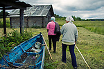 Anna and Olga have finished their daily routine in a field. For some time many people live on subsistence farming only and depend from a fair yield to live winter monthes