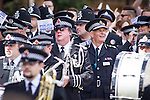 "© Joel Goodman - 07973 332324 . 23/08/2014 .  Manchester , UK . The Chief Constable of Greater Manchester Police , SIR PETER FAHY . The parade through Manchester City Centre . Manchester Pride "" Big Weekend "" in Manchester "" today ( 23rd August 2014 ) . Photo credit : Joel Goodman"