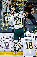 26 January 2019: University of Vermont Catamount Forward Max Kaufman, a Sophomore from Rochester, NY, celebrates scoring the game winning goal in overtime with a happy fan at 3:40 in to the period against the Merrimack College Warriors at Gutterson Fieldhouse in Burlington, Vermont. The Catamounts defeated the Warriors 4-3 in overtime to take both games of their weekend America East conference series. Mandatory Credit: Ed Wolfstein Photo *** RAW (NEF) Image File Available ***