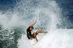 01 December 2004, Oahu, Hawaii --- Professional surfer Iker Fuentes in action on a reef wave at the North Shore's Backdoor break, Oahu island, Hawaii. Photo by Victor Fraile --- Image by © Victor Fraile/Corbis