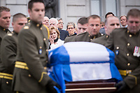 Lisette Lapointe, wife of former Quebec premier Jacques Parizeau, wipes a tear as his casket leaves the National Assembly in Quebec City on Sunday June 7, 2015.<br /> <br /> PHOTO :  Francis Vachon - Agence Quebec Presse