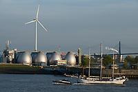 GERMANY, Hamburg, annual port event Hafengeburtstag with sailing ships on river Elbe and Nordex wind turbine at Hamburg Wasser Koehlbrandhoeft / DEUTSCHLAND Hamburg, Hafengeburtstag, Boote, Schiffe auf der Elbe vor Nordex Windkraftanlage auf dem Koehlbrandhoeft von Hamburg Wasser, Faultuerme der Biogasanlage auf dem Klaerwerk