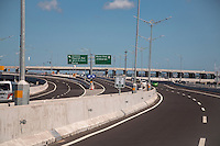 Bali, Indonesia.  Expressway, Super Highway, Modern Roadway.  Sign to Airport.  Driving on the Left.