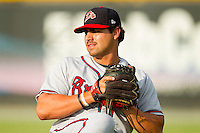 Michael Hashem (26) of the Danville Braves warms up in the outfield prior to the game against the Burlington Royals at Burlington Athletic Park on July 19, 2012 in Burlington, North Carolina.  The Royals defeated the Braves 4-3.  (Brian Westerholt/Four Seam Images)