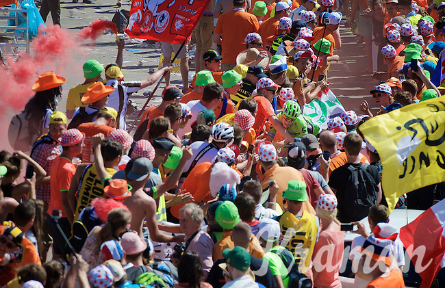 coming close to crashing  as he is obstructed by a fan (of which most were drunk) at the Dutch Corner (nr7) up Alpe d'Huez<br /> <br /> stage 20: Modane Valfréjus - Alpe d'Huez (111km)<br /> 2015 Tour de France