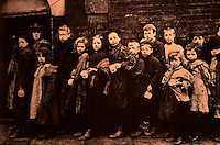 """London: Historical East End--Children lining up for """"Farthing Breakfasts"""", Hanbury Street, 1880. Wm. J. Fishman, STREETS OF EAST LONDON.  Reference only."""