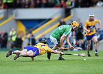 Pauric Mc Namara of Clare in action against Josh Adams of Limerick during their Munster U-21 hurling quarter final at Cusack park. Photograph by John Kelly.