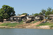 Pará State, Brazil. São Félix do Xingu. Poor riverside housing with satellite television dishes.