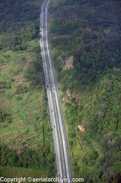 aerial photograph of the Pan-American Highway passing through forest in Panama | fotografía aérea de la Carretera Panamericana que pasa por el bosque en Panamá