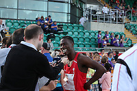 Tuesday 15th July 2014<br /> Pictured: Christian Malcolm<br /> RE: Welsh sprinter Christian Malcolm, smiling while  interviewed by the media after competing in the 4x100m relay at the Welsh Athletics International in the Cardiff International Sports Stadium, South Wales, UK. His last race on home soil.