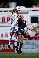 Maren Knudsen (30) of Maryland goes up for a header with Kendall Fischlein (23) of Wake Forest during the game at Ludwig Field in College Park, MD.  Maryland defeated Wake Forest, 1-0.