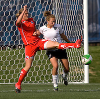 Christie Welsh of the Washington Freedom fights for the ball with Nikki Krzysik of the Philadelphia Independence during their preseason game at the Maryland SoccerPlex in Germantown, Maryland.