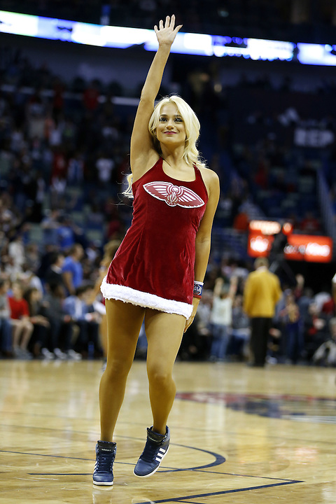A New Orleans Pelicans cheerleader performs during the first half of an NBA basketball game Wednesday, Dec. 23, 2015, in New Orleans. (AP Photo/Jonathan Bachman)
