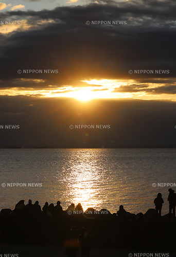 January 1, 2020, Tokyo, Japan - People watch the sunrise which appears behind the clouds on the New Year's Day at a beach in Tokyo on Wednesday, January 1, 2020. Millions of Japanese people visit shrines and temples to celebrate the New Year.    (Photo by Yoshio Tsunoda/AFLO)