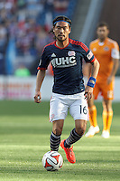 New England Revolution midfielder Daigo Kobayashi (16) looks to pass. In a Major League Soccer (MLS) match, the New England Revolution (blue/white) defeated Houston Dynamo (orange), 2-0, at Gillette Stadium on April 12, 2014.