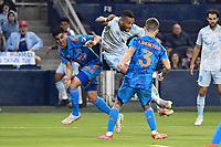 KANSAS CITY, KS - MAY 29: Khiry Shelton #11 Sporting KC in the air during a game between Houston Dynamo and Sporting Kansas City at Children's Mercy Park on May 29, 2021 in Kansas City, Kansas.