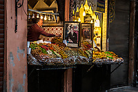 Marrakesh, Morocco.  Souk  Vendor of Pastries and Sweets, with Photo of King Muhammad VI.
