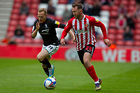 22nd May 2021; Stadium of Light, Sunderland, Tyne and Wear, England; English Football League, Playoff, Sunderland versus Lincoln City; Carl Winchester of Sunderland charges passed Anthony Scully of Lincoln City,