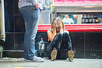 Saturday  17 December 2016<br /> Pictured: A girl is ill outside a Kebab shop on Swansea's Wind Street <br /> Re: Swansea City Centre and the notorious Wind street, often nicknamed 'Wine Street' is packed full of Christmas jumpers and glitzy dresses as thousands head to office dos across the UK in the biggest party night of the year.