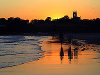 An evening stroll at Second Beach in Newport ends with a beautiful sunset view of St. Georges.