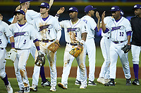 Yeyson Yrizarri (2) of the Winston-Salem Dash high fives teammates following their win over the cm\ at BB&T Ballpark on June 1, 2019 in Winston-Salem, North Carolina. The Dash defeated the Mudcats 5-4 in game two of a double header. (Brian Westerholt/Four Seam Images)