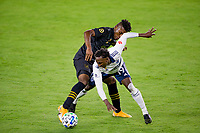 LOS ANGELES, CA - SEPTEMBER 23: Latif Blessing #7 of LAFC and Janio Bikel #19 of the Vancouver Whitecaps battle for a ball during a game between Vancouver Whitecaps and Los Angeles FC at Banc of California Stadium on September 23, 2020 in Los Angeles, California.