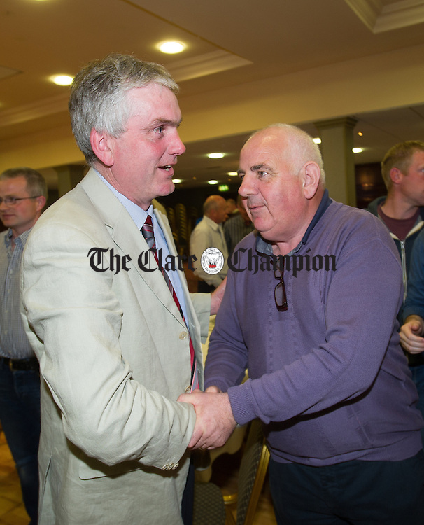 Fine Gael's Pat Burke is congratulated by fellow Fine Gael candidate Sean Mc Loughlin following his election at the election count at The West county Hotel, Ennis. Photograph by John Kelly.