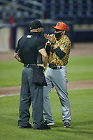 Down East Wood Ducks manager Carlos Cardoza (6) argues a call with home plate umpire Lane Cullipher during the game against the Kannapolis Cannon Ballers at Atrium Health Ballpark on May 8, 2021 in Kannapolis, North Carolina. (Brian Westerholt/Four Seam Images)