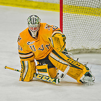 19 February 2016: University of Vermont Catamount Goaltender Packy Munson, a Freshman from Hugo, MN, makes a second period stick save against the Boston College Eagles at Gutterson Fieldhouse in Burlington, Vermont. The Eagles defeated the Catamounts 3-1 in the first game of their weekend series. Mandatory Credit: Ed Wolfstein Photo *** RAW (NEF) Image File Available ***