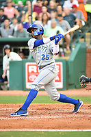 Southern Divisions right fielder Seuly Matias (25) of the Lexington Legends swings at a pitch during the South Atlantic League All Star Game at First National Bank Field on June 19, 2018 in Greensboro, North Carolina. The game Southern Division defeated the Northern Division 9-5. (Tony Farlow/Four Seam Images)