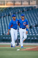 AZL Cubs 2 starting pitcher Manuel Espinoza (73) and first baseman Abraham Rodriguez (12) walk off the field between innings of an Arizona League game against the AZL Dbacks on June 25, 2019 at Sloan Park in Mesa, Arizona. AZL Cubs 2 defeated the AZL Dbacks 4-0. (Zachary Lucy/Four Seam Images)