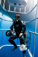 Underwater photographer in a cage at Isla Guadalope, Mexico