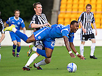 St Johnstone v St Mirren...11.09.10  .Jennison Myrie-Williams is fouled by Sean Lynch.Picture by Graeme Hart..Copyright Perthshire Picture Agency.Tel: 01738 623350  Mobile: 07990 594431