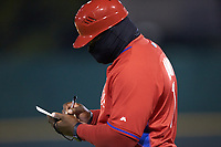 Philadelphia Phillies scout Tim Moni takes notes as he coaches first base during the East Coast Pro Showcase at the Hoover Met Complex on August 2, 2020 in Hoover, AL. (Brian Westerholt/Four Seam Images)