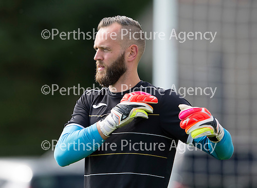 St Johnstone Training…29.07.16<br />Keeper Alan Mannus stretches during training this morning at McDiarmid Park<br />Picture by Graeme Hart.<br />Copyright Perthshire Picture Agency<br />Tel: 01738 623350  Mobile: 07990 594431